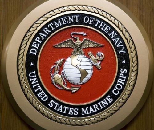 The US Marine Corps logo hangs on the wall at the Pentagon in Washington, DC on  February 24, 2009
