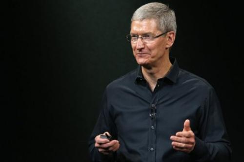Tim Cook speaks on stage during an Apple product announcement in Cupertino, California on September 10, 2013