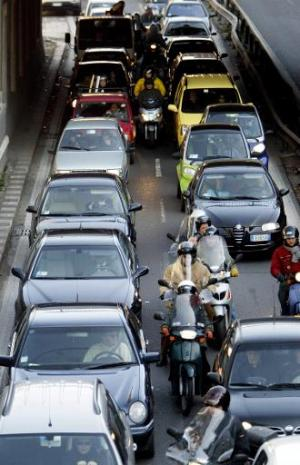 Traffic during a rush-hour is seen on a street of Rome on January 30, 2004