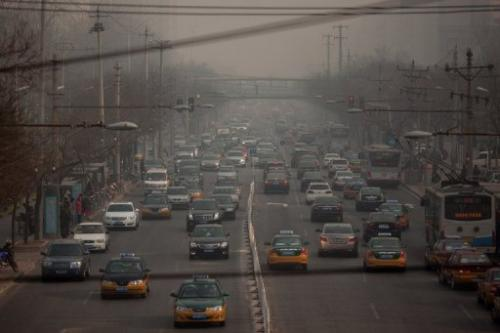 Traffic makes its way through Beijing on January 12, 2013