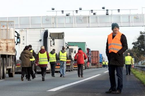 Truck drivers block a part of the A10 highway near Marcheprime, western France, to protest against an environmental tax on Novem