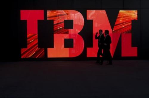 Two men walk past an IBM logo on February 28, 2011 in Hanover, central Germany