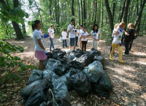 Volunteers of 'Let's do it Romania!' finish cleaning up the forest of Mogosoaia near Bucharest on September 24, 2011