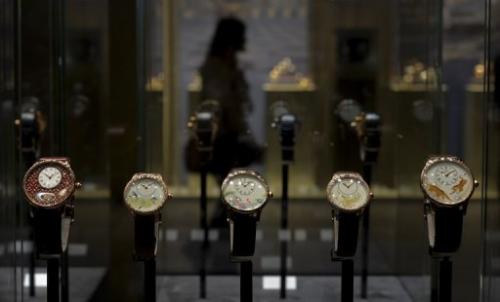 Watches by Swiss watchmaker Jacquet Droz are displayed on the opening day of watch fair Baselworld on April 25, 2013