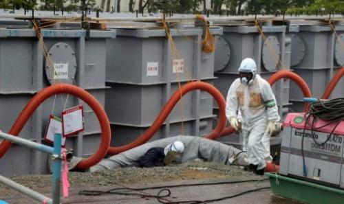 Workers at the Fukushima nuclear plant on June 12, 2013