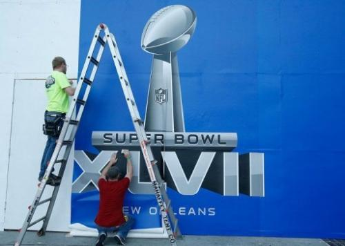 Workers put the finishing touches to a Super Bowl sign, on January 29, 2013, in New Orleans