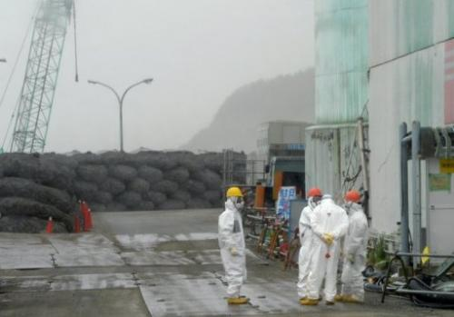 Workers take a break at Japan's Fukushima Dai-ichi nuclear plant in Okuma town in Fukushima prefecture on June 12, 2013