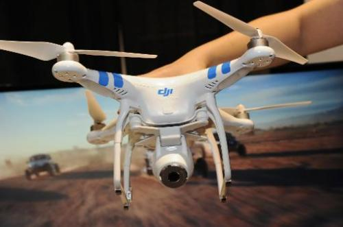 "A DJI Innovations DJI Phantom 2 Vision aerial system drone is shown during ""CES: Unveiled,"" the media preview for Inte"