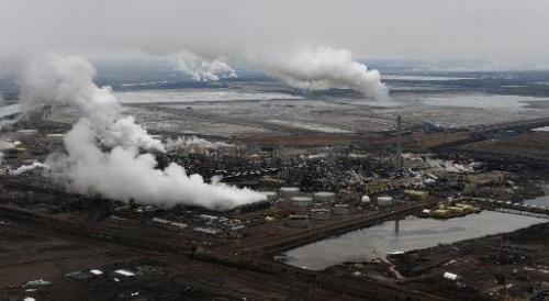 Aerial view of the Syncrude oil sands extraction facility with the Suncor extraction facility in the background, in Alberta Prov