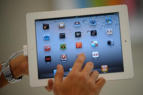 A man uses an iPad 2 during its launch in the Philippines at an Apple store in Manila on April 29, 2011