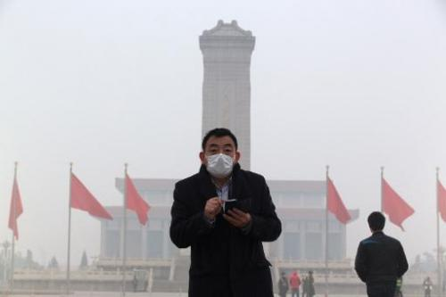 A man walks through a haze-shrouded Tiananmen Square  in Beijing on February 23, 2014