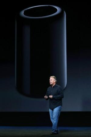 Apple Senior Vice President of Worldwide Marketing Phil Schiller announces the new Mac Pro during an Apple announcement at the Y