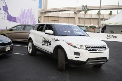 A Range Rover Evoque equipped with Valeo self-parking technology backs into a parking spot during a driverless car demo at the I