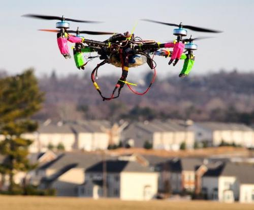 A small remote-controlled drone hovers in the sky at the DC Area Drone User Group meet-up on February 1, 2014