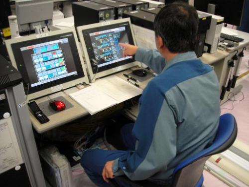 A TEPCO employee at the control room of the Fukushima nuclear power plant at Okuma town in Fukushima prefecture on May 21, 2014