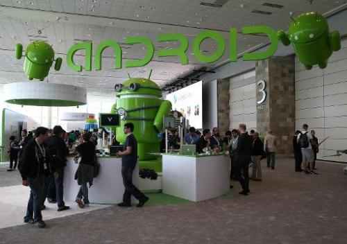Attendees visit the Android booth during the Google I/O developers conference at the Moscone Center on May 15, 2013 in San Franc