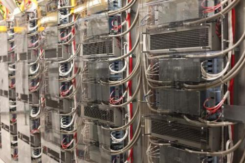 Bays of equipment line the 2G area at an AT&T mobile telephone switching office on October 25, 2012 in Charlotte, North Caro