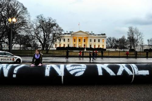 Environmental activists protest against the Keystone pipeline project in front of the White House in Washington, DC, on February