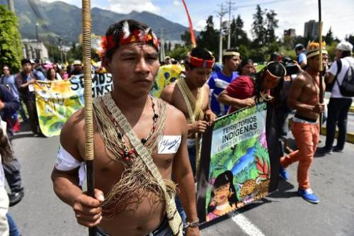 Huaorani natives and ecologist group activists march in Quito, Ecuador, on April 12, 2014, toward the National Electoral Council