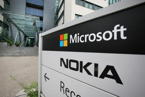 Microsoft and Nokia signs pictured outside an office in Peltola Oulu, Finland, on July 16, 2014