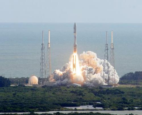 NASA's Curiosity rover, formally known as the Mars Science Laboratory, heads for space on November 26, 2011, atop an Atlas 5 roc