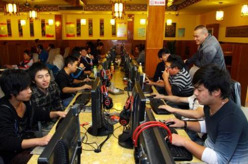 People are seen at an Internet cafe in Jiashan, east China's Zhejiang province, on November 2, 2012
