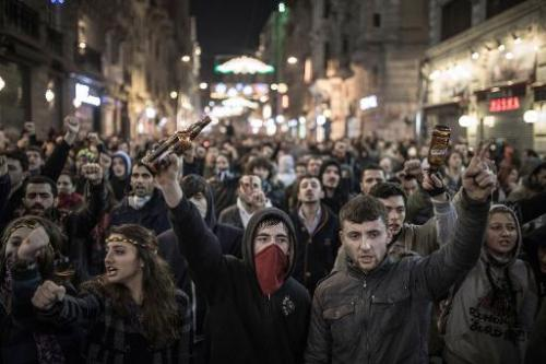 Protesters chant slogans against newly proposed restrictions on the use of the Internet in Istanbul, on January 18, 2014