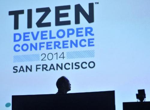 Samsung Executive Vice President Jong-Deok Choi watches a video during the Tizen Developer Conference in San Francisco, Californ