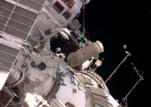 Spacewalking astronauts release baby satellite (Update)