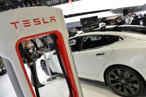 The Tesla P85+ all electric car and its charging station are displayed at the North American International Auto Show in Detroit