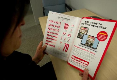 This December 24, 2012 photo shows a woman perusing the final print edition of Newsweek in Washington, DC