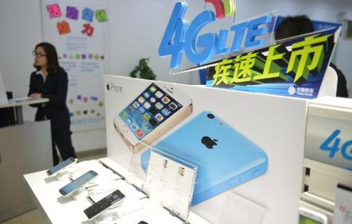 This picture taken on January 14, 2014, shows an Apple iPhone advertised in a China Mobile store in Shanghai
