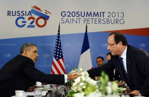 US President Barack Obama (L) shakes hands with French President Francois Hollande during a bilateral meeting in Saint Petersbur