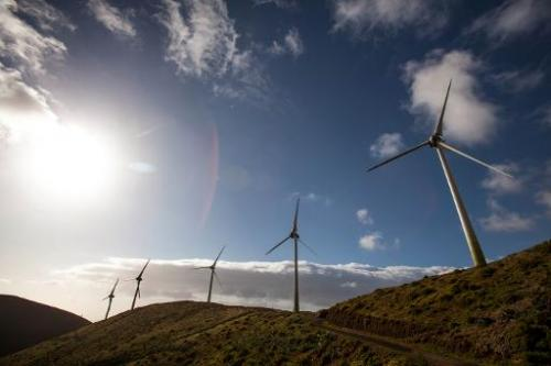 Wind turbines are pictured near the upper reservoir of the Gorona power station on El Hierro island on March 28, 2014