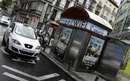 A picture taken on July 3, 2014 shows an advertisement for wifi provider Gowex on a news kiosk in Madrid