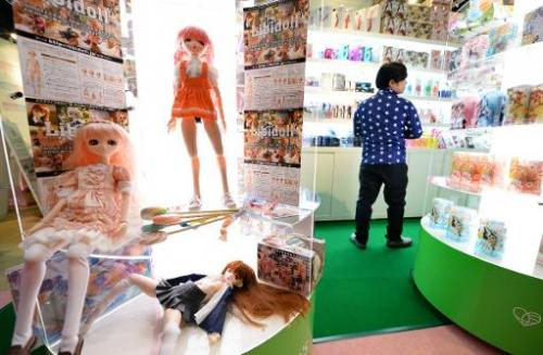 A visitor looks at sex toys at a booth of adult goods at the Pink Tokyo sex toy fair, on February 28, 2014