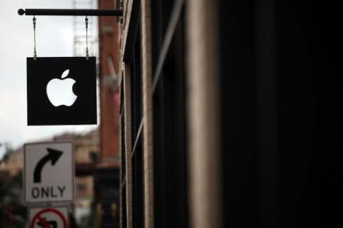 The Apple logo is viewed in front of an Apple store on July 23, 2013 in New York City