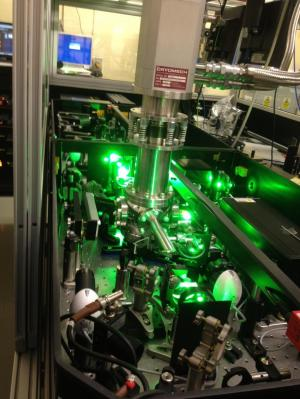Breakthrough laser experiment reveals liquid-like motion of atoms in an ultra-cold cluster