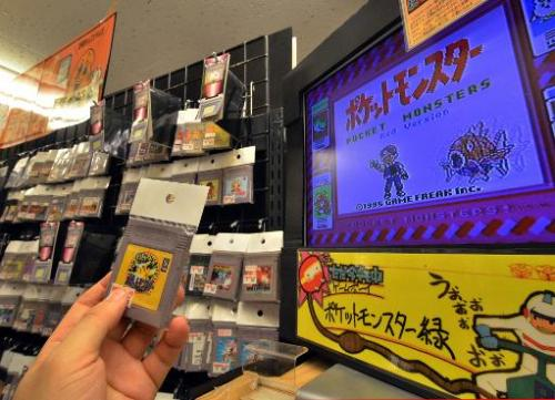 A customer checks out videogame software for Nintendo's Game Boy, at a shop in Tokyo, on April 17, 2014