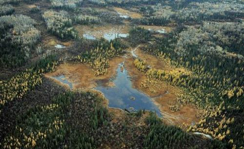 Aerial view of a lake and forests in Alberta Province, Canada on October 23, 2009