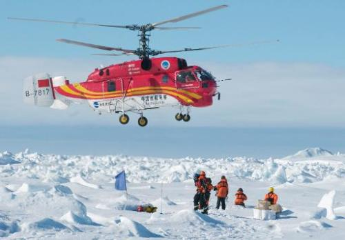 A helicopter from the Chinese ship Xue Long rescues passengers who spent Christmas on the icebound Russian research vessel Akade