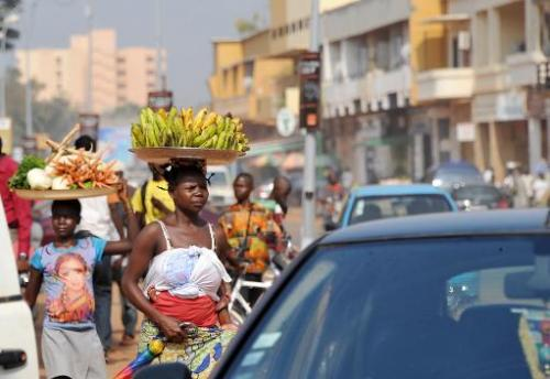A woman carries bananas on her head in Bangui on February 25, 2014