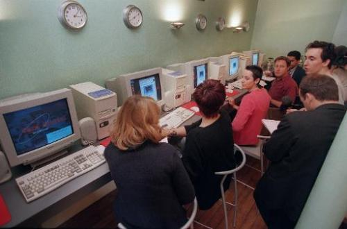 "File picture shows customers at the ""Café orbital"" in Paris in 1995, the first Internet cafe in France to give its cus"