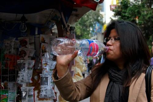 Mexico City bets on tap water law to change habit