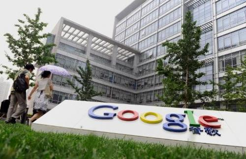 Pedestrians walk pass the Google China headquarters in Beijing on June 30, 2010