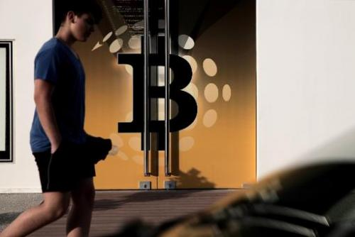 A man walks past the bitcoin firm Neo&Bee offices on April 3, 2014 in the Cypriot capital Nicosia