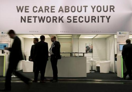 In this file photo, a stand offering security solutions for the internet is seen at the CeBIT computer technology trade fair in