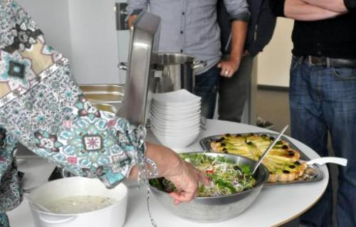 Picture taken on May 8, 2014 shows 63-year-old German Angela Runge presenting some food she has prepared for young software desi