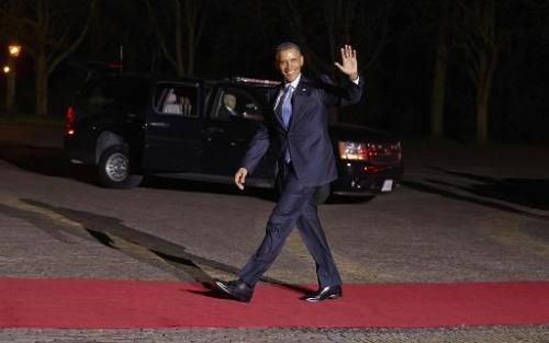 US President Barack Obama waves as he arrives at the Royal Palace Huis ten Bosch in The Hague on March 24, 2014