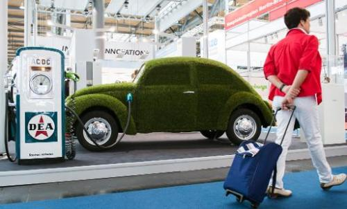 This picture taken on April 7, 2014 shows a grass covered mock VW electronic beetle car at the Hannover Messe industrial trade f